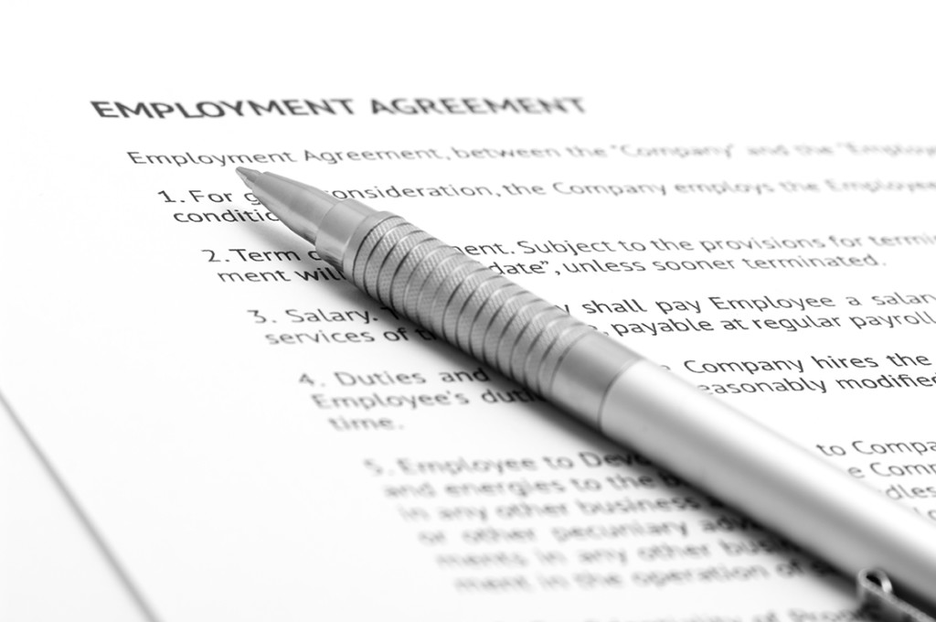 Employment Contracts employment form and pen
