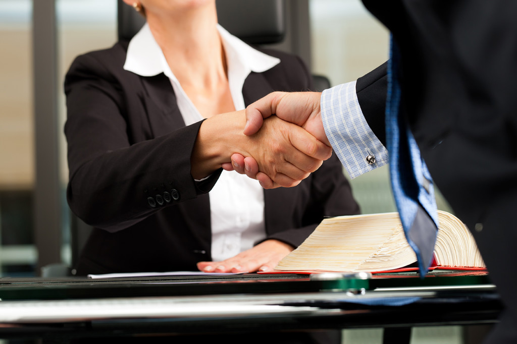 Partnership and Shareholder Disputes two people shaking hands